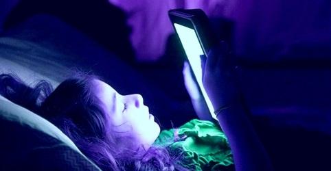 girl using a tab in dark